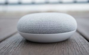 A picture of a Google Home Mini device. Source: Google.